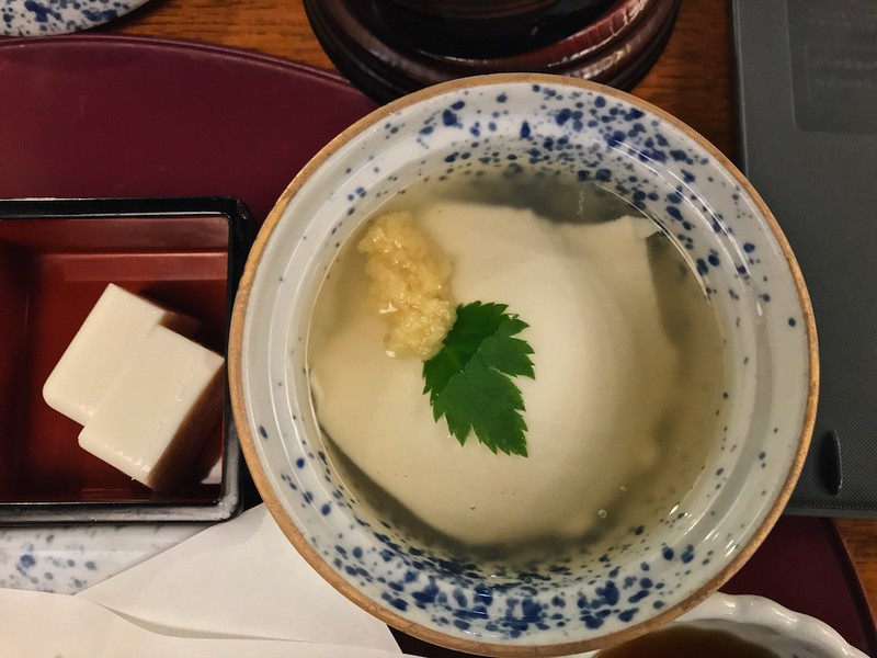 A large scoop of yose tofu is topped with a small mound of grated ginger.