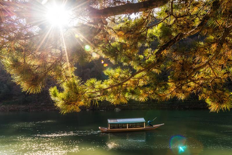 Scenic boat ride down the Hozugawa River in Arashiyama.