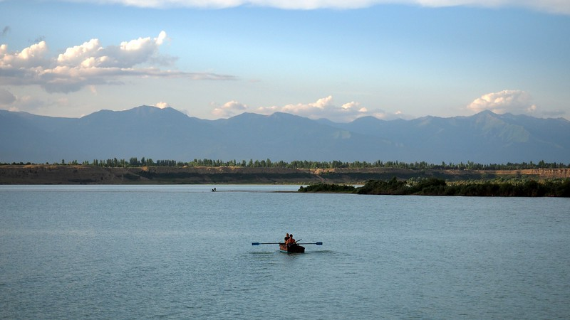 Views of a rowboat during our sunset cruise on Lake Issyk-Kul Ысык Көл Иссык Куль Przhevalsky Bay in Karakol, Kyrgyzstan