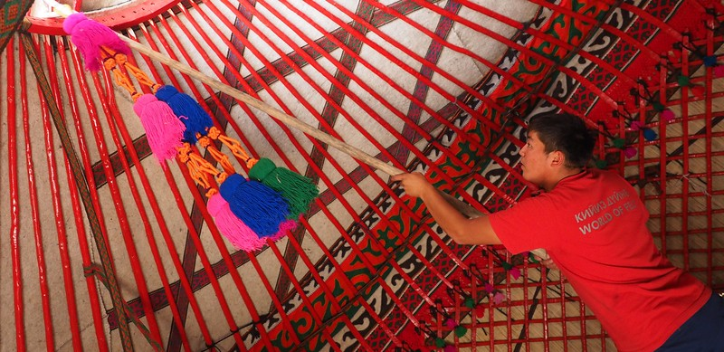Decorating the interior of a Kyrgyz yurt in Kyzyl-Tuu.