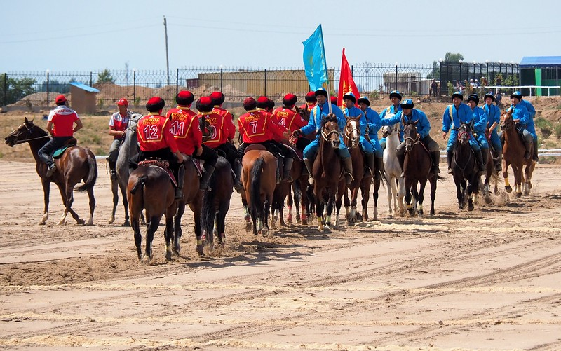 Team Kyrgyzstan and team Kazakhstan shacking hands after a Kok Boru match at the World Nomad Games