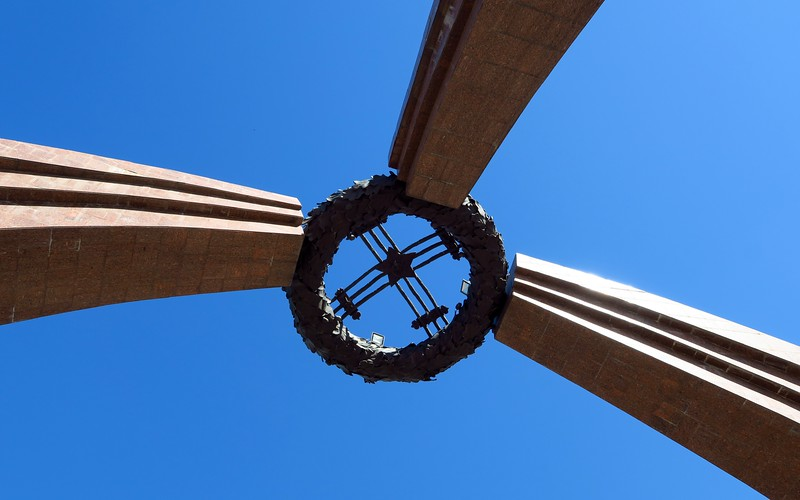 Standing below the Victory monument and looking upwards in Bishkek, Kyrgyzstan