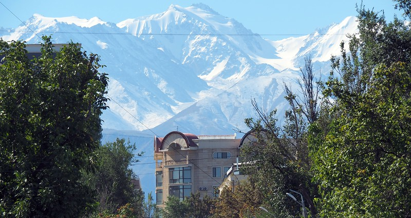 Stunning snow capped mountain views off in the distance from Bishkek, Kyrgyzstan