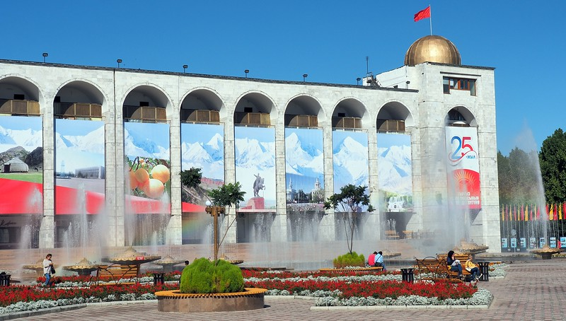 People walking around Ala-Too Square in Bishkek, Kyrgyzstan