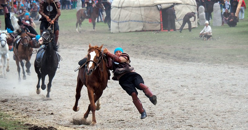 A talented performer doing equestrian tricks at the World Nomad Games in Kyrgyzstan
