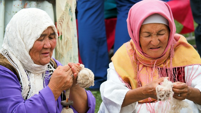 Two Kyrgyz ladies knitting during the World Nomad Games in Krygyzstan