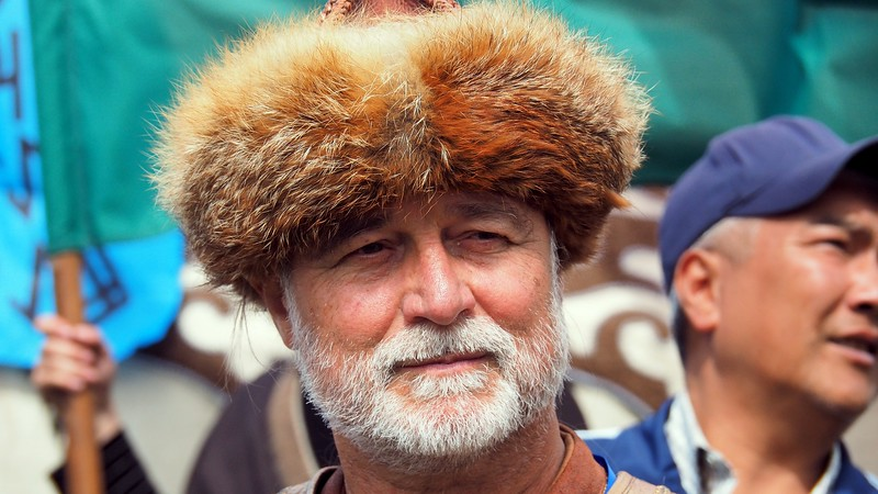 A man wearing a distinct hat at the Kyrgyzstan games