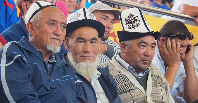 Men wearing traditional Kyrgyz hats attending the World Nomad Games in Kyrgyzstan