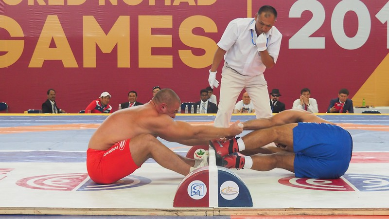 Intense Mas-wrestling match from two competitors at the World Nomad Games in Kyrgyzstan