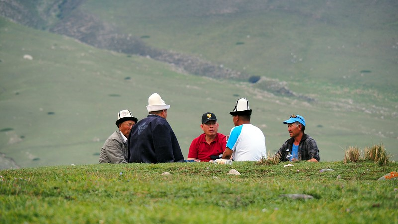 Some Kyrgyz men gather for a quiet picnic at the World Nomad Games in Kyrgyzstan
