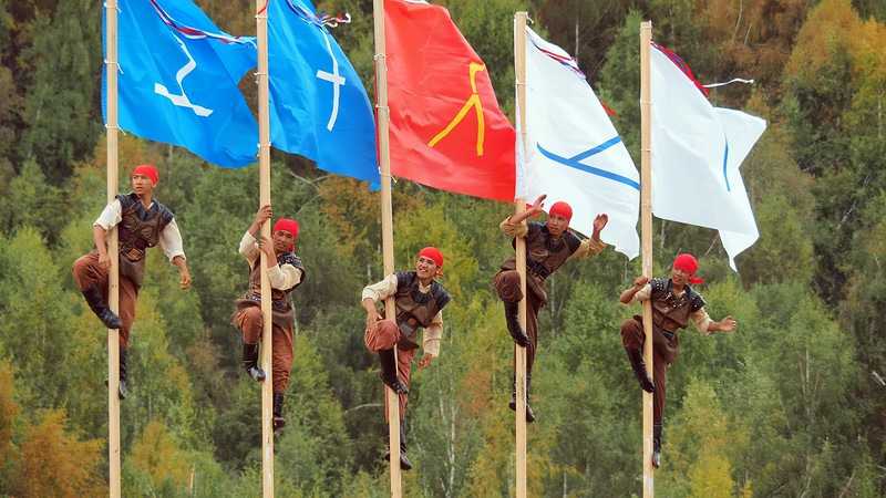 Men climbing a pole during a cultural performance at the World Nomad Games in Kyrgyzstan