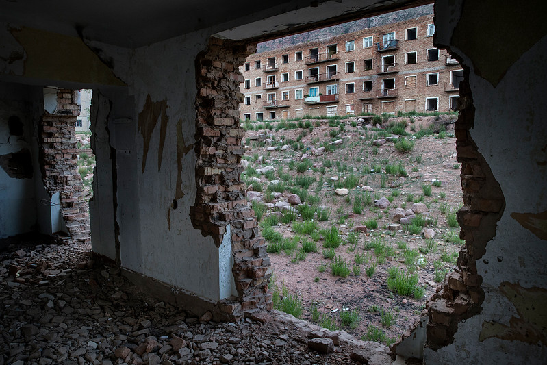 Broken buildings in Kadji-Sai. The buildings were built by German prisoner of war during WWII, when Kyrgyzstan was part of the Soviet union.