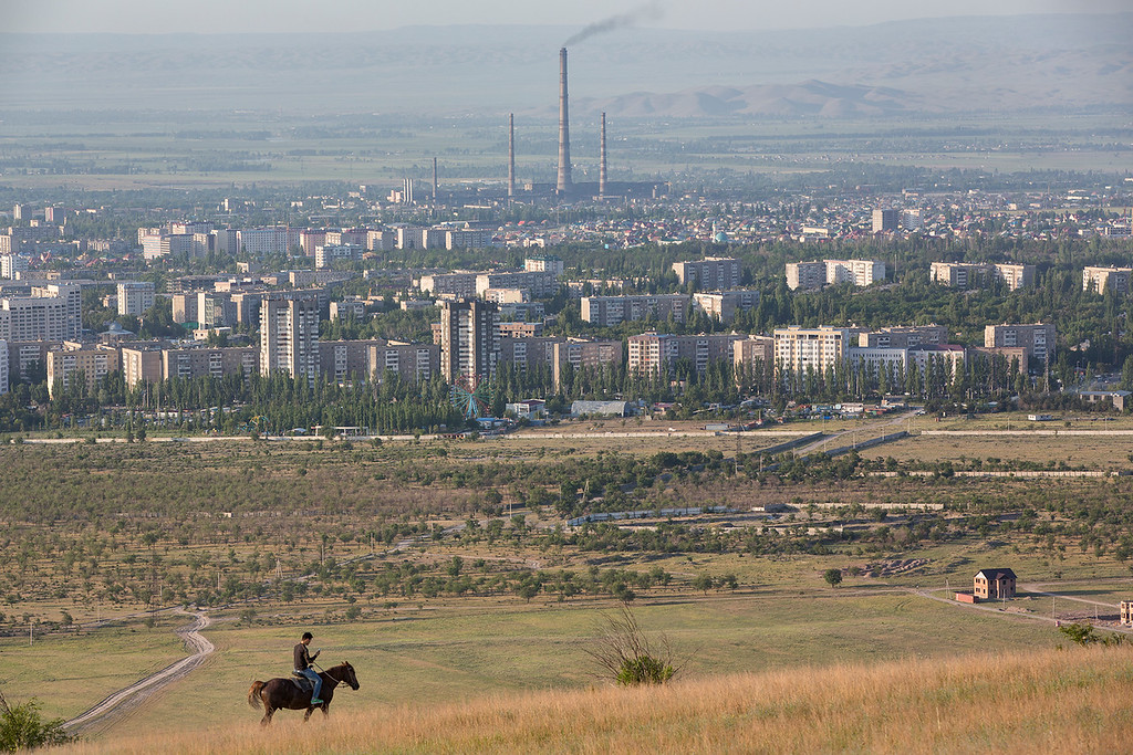 Horse and rider in front of Bishkek.
