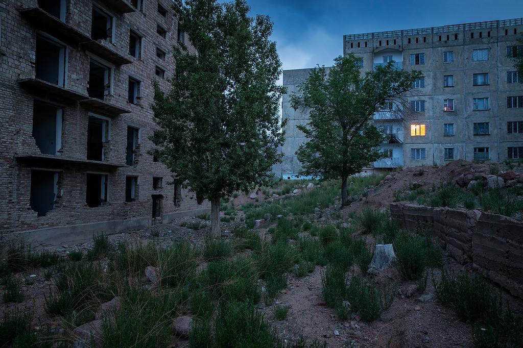 Broken buildings in Kadji-Sai. The buildings were built by German prisoner of war during WWII, when Kyrgyzstan was part of the Soviet union.