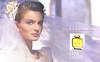 ESTÉE LAUDER Beautiful 1988-1989 US spread (format 22,5 x 27 cm) 'This is your moment to be beautiful'<br /> <br /> MODEL: Paulina Porizkova, PHOTO: Skrebneski; <br /> Dress: Isaak Mizrahi, headpiece: Victoria Di Nardo, earrings: H.S.Stern Jewelers