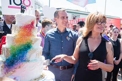 2018 LA Pride Grand Marshal Michaela Mendelsohn, a trandgender activist and respected entrepreneur cuts the symbolic wedding cake with Los Angeles Mayor Garcetti on hand