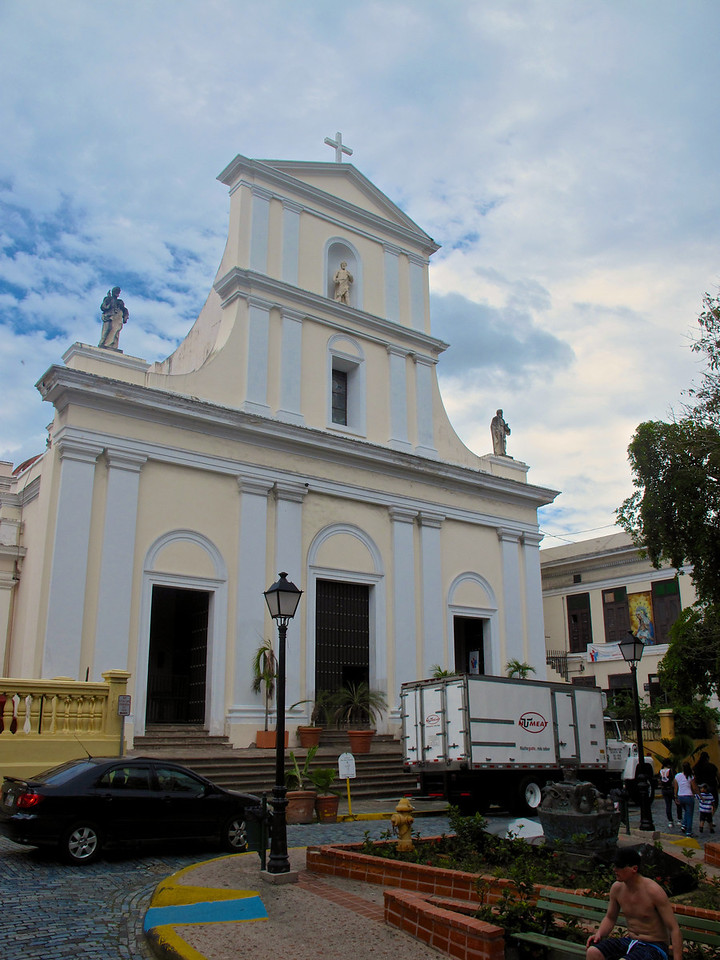 The Cathedral of San Juan Bautista is a Roman Catholic cathedral in Old San Juan.  It is one of the oldest buildings in San Juan, and is the second oldest cathedral in the Americas. The cathedral contains the tomb of the Spanish explorer and settlement founder Juan Ponce de León. It also has the relics of Carlos Manuel Rodríguez Santiago, the first Puerto Rican, the first Caribbean-born layperson and the first layperson in the history of the United States to be beatified.[