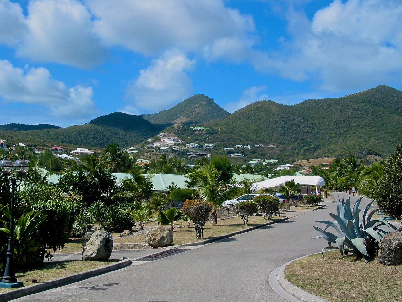 The island's French side is known for its nude beaches, clothes, shopping (including outdoor markets), and rich French and Indian Caribbean cuisine.