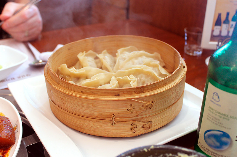 Mandu!  Dumplings filled with seasoned meat and onion, in delicate wrappers, served in bamboo steamers.