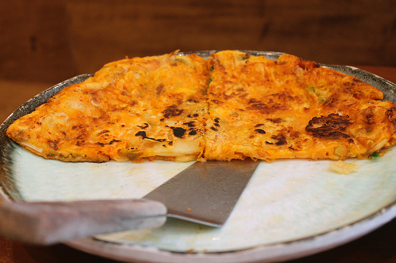 Kimchi pa jeon (kim chee pah jon) - crispy kimchi and scallion pancake, served with a soy dipping sauce.  A meal in itself!