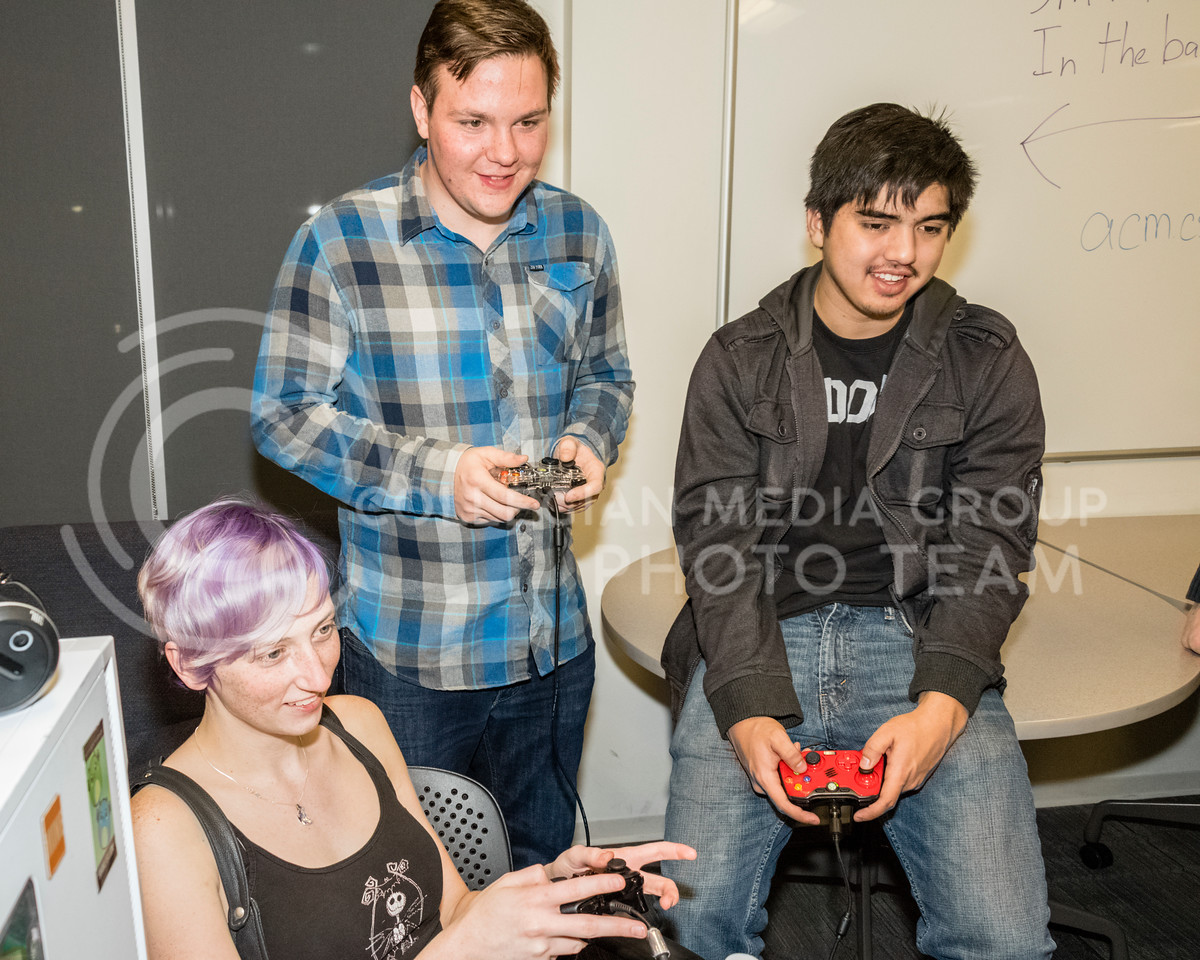 Michael Darnall, Matthew Gier, and Chloe Henderson play Overcooked at a Local Area Network (LAN) party on Dec 1, 2017. The Association for Computing Machinery (ACM) and Sponsor Suftek put on a LAN Party at the College of Engineering on Dec 1, 2017. (Alex Shaw | Collegian Media Group)