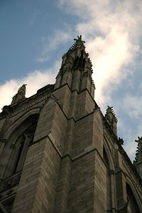 Gothic architecture. The top of the spires seemed to be moving as the clouds scuttled across the sky.