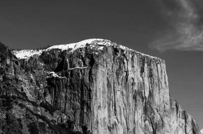 El Capitan 70-200mm f2.8 ISO200 This was shot from the Tunnel View with a telephoto lens, originally shot in color, I converted it to Black and White.  I like the dusting of snow on El Caps' cap.