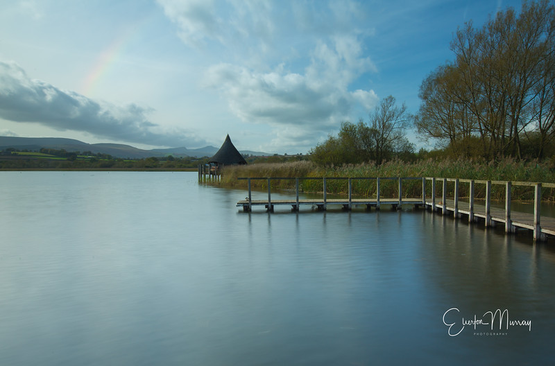 Llangorse lake and jetty, with rainbow