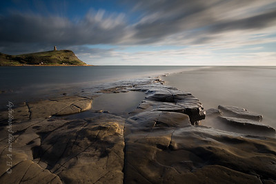 Kimmeridge bay in dorset with clavells tower in the distance