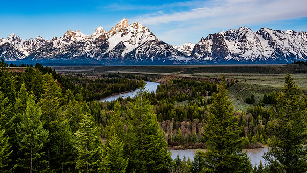 The Tetons at sunrise, a wide view as seen from the Snake River Overlook