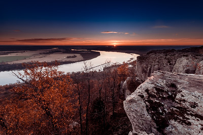 Beautiful sunrise over the Arkansas river from the Overlook at Petit Jean grave site