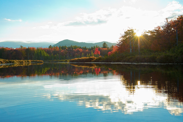 Sun rays illuminate peak foliage on Adirondacks stream • Fall Stream, Piseco NY • 2013