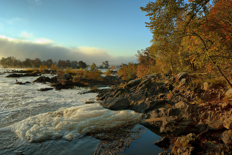 MORNING FOG AND MIST RISING FROM THE POTOMAC RIVER WITH NATURAL FOAM IN GREAT FALLS VA