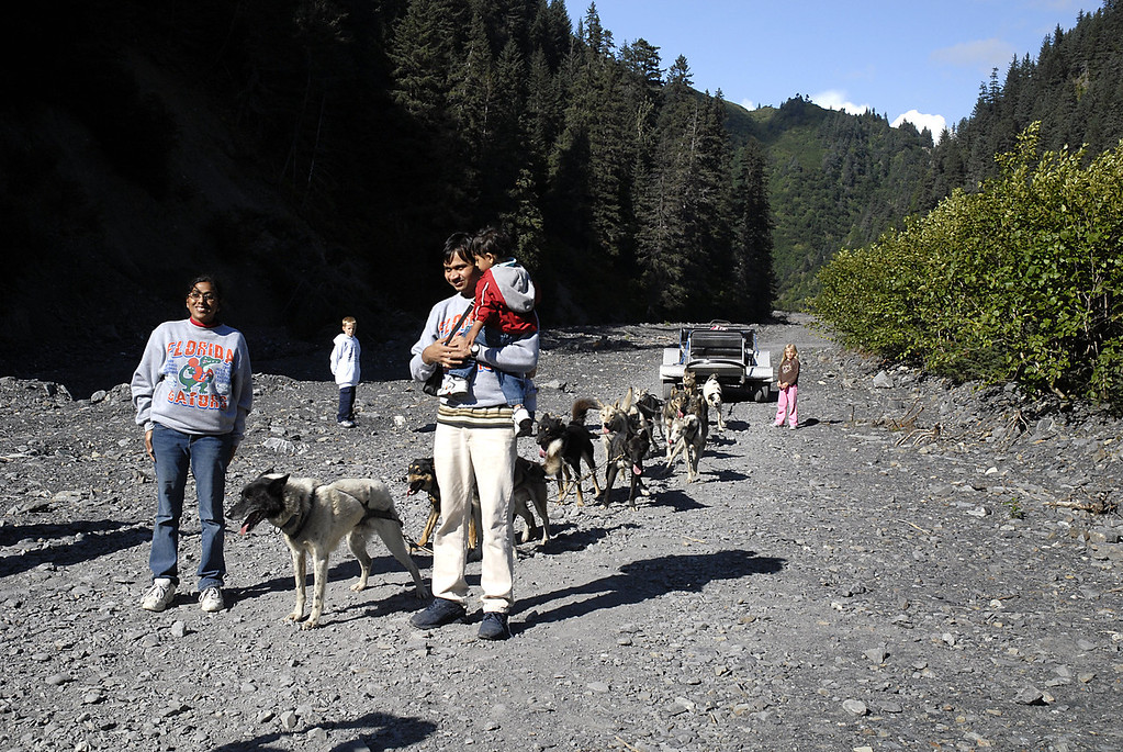Seattle family standing with 2nd dog sled team-Box Canyon-Seward, AK 8-31-2007