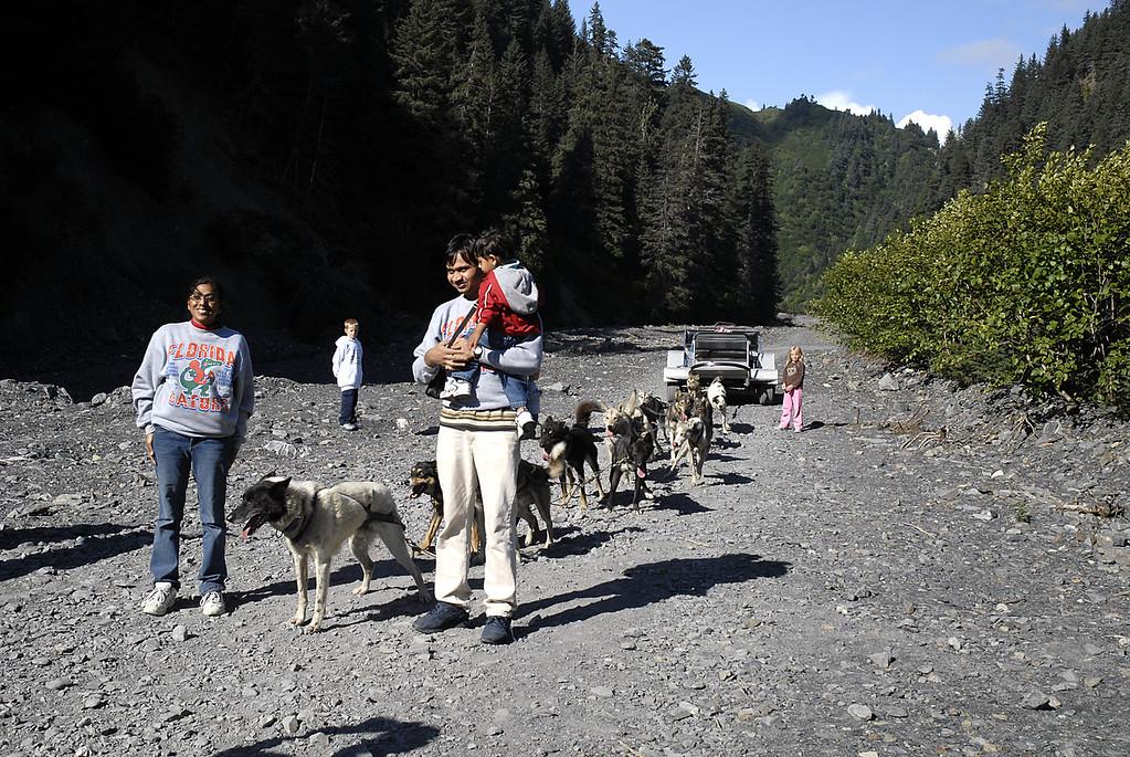Seattle family standing with 2nd dog sled team-Box Canyon-Seward, AK 8-31-2007