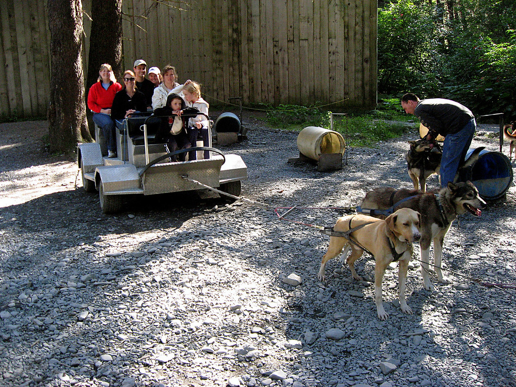 Rob & Kelly waiting in dog cart while team gets harnessed-Seward, Alaska 8-31-2007