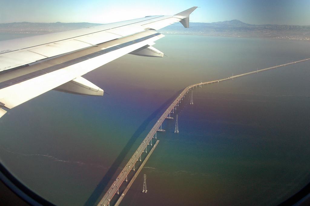 San Francisco-Oakland Bay Bridge below plane-California 2-14-06