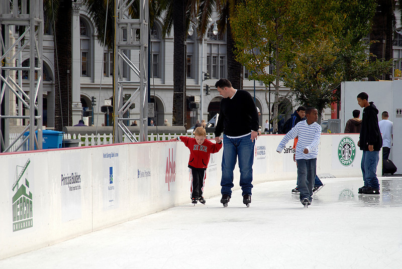 dad teaching kid to skate on thin ice-Embarcadero Center-San Francisco, CA 11-12-2007