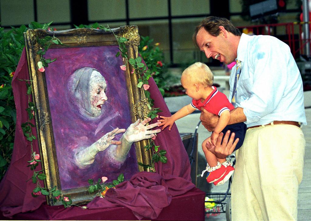 Buskers Fair portrait meets boy & dad - WTC 1997 June
