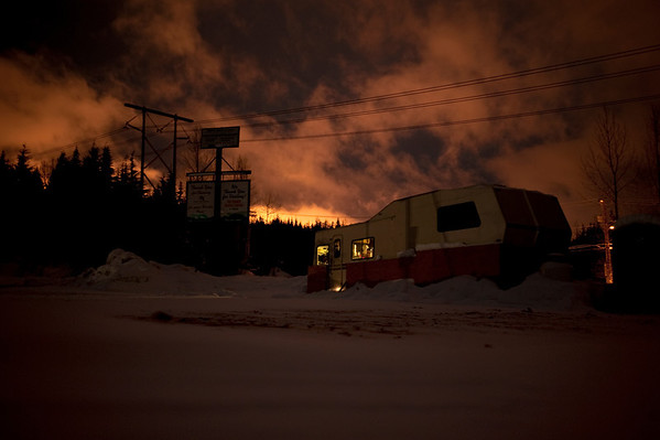 snowed-in trailer & clouds lit by ski slopes-Summit East-Hyak, WA 12-20-2010