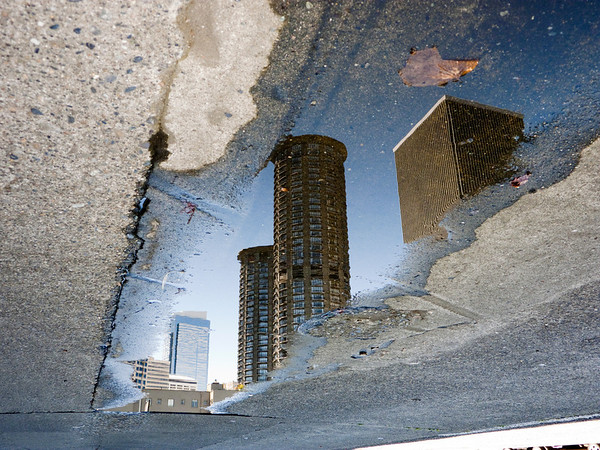 Westin Hotel round towers reflected in puddle-downtown Seattle, WA 6-2010