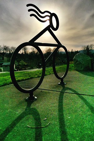girl on bicycle sculpture-Issaquah Highlands park 3-2015