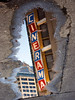 Cinerama sign reflected in puddle-downtown Seattle, WA 6-2010