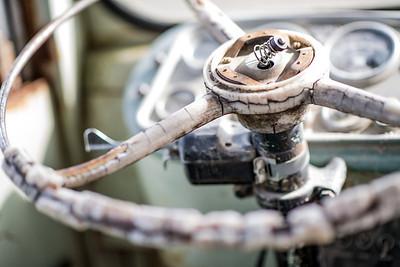 steering wheel on dilapidated transport bus-Skagit Valley, WA 4-10-2014