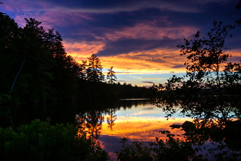 Stormy clouds at sunset on Loon Pond
