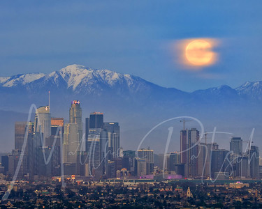 Super Moon Rise over LA from Kenneth Hahn Park.    I waited for the burn to happen after the moon went behind the clouds while recording a timelapase.  The atmosphere was going nuts behind us and the purple was reflecting off of the buildings.   ---------- Shot alongside @la_reflections @philsutphin @ericjon23 patrickc_la bay.photography creative_spur rmedinag450 @cecphotos @jw88photo evosia roberthigs and tag yourself if you were there!