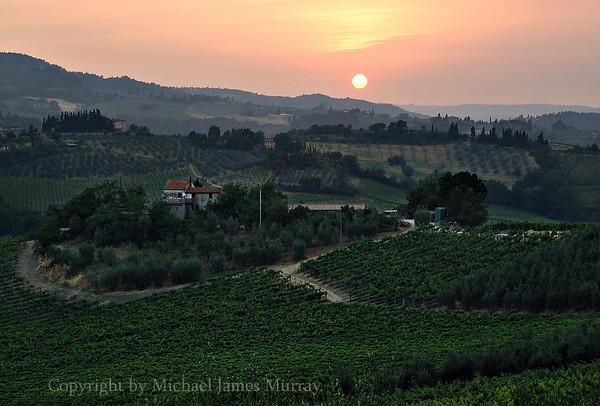 Sunset over Tuscan Farmland, San Gimignano, Italy.