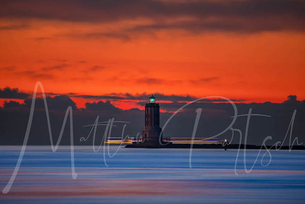 Merry Christmas Eve  Blue hour with a Christmas lighted boat. Port of LA lighthouse