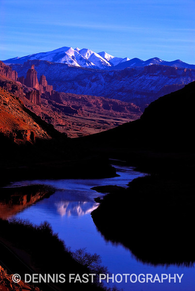 FRASER TOWERS & LA SAL MOUNTAINS, MOAB, UTAH.  The light was just perfect in the late afternoon to capture the famous Fisher Towers offset by the La Sal Mountains in the distance. Of course, a reflection never hurt a photograph either!