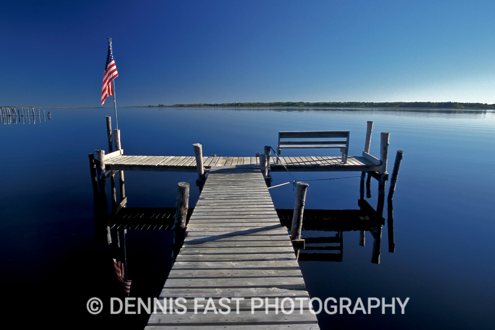 AFTER 911.  I made this image while shooting for a book on Lake of the Woods for Heartland Publishing. I still had the southern part of the lake to photograph (the part that is in Minnesota) when the terrible tragedy of 9/11 happened. I waited for a few days before heading out and came across this quiet, and somewhat somber scene at the time, near a small fishing camp. I felt both serenity and sadness as I took this photo knowing that the USA and the world had changed forever.